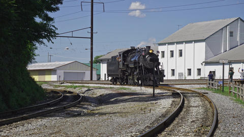Antique Steam Locomotive Traveling Around a Bend on a Spur to Hook Up With a Train Live Action