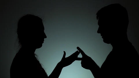 A man and a woman play rock-paper-scissors. Emotions, joint rest, games Live Action