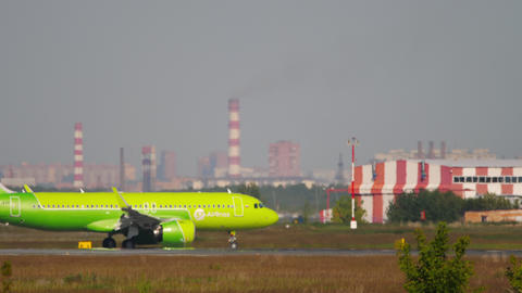 S7 Airlines Airbus A320 airliner taxiing after landing Live Action