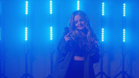 Live vocal performance of emotional singer in denim jacket, vocalist girl Live Action