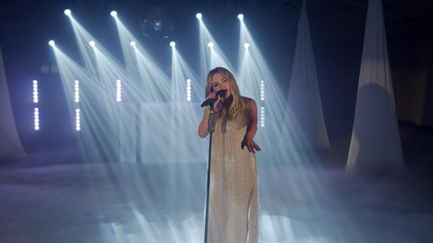 Live vocal performance of emotional singer, vocalist girl dancing, singing on Live Action