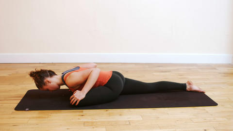 Woman doing stretching exercise on exercise mat Live Action