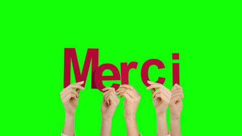 Hands holding up merci Stock Video Footage