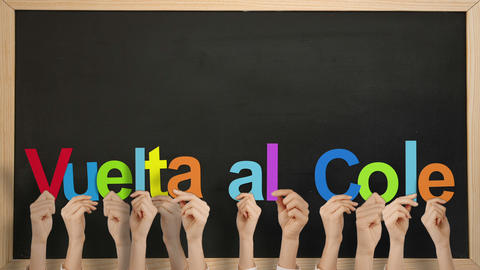 Hands holding up vuelta al cole Animation