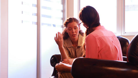 Female patient having discussion with therapist Live Action