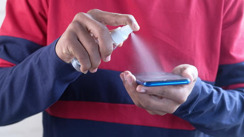 young man cleaning mobile phone display ライブ動画