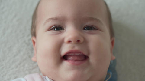 infant, childhood, hygiene concept - close-up of smiling happy funny chubby face Live Action