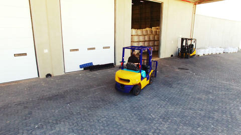 Warehouse worker driving forklift Footage