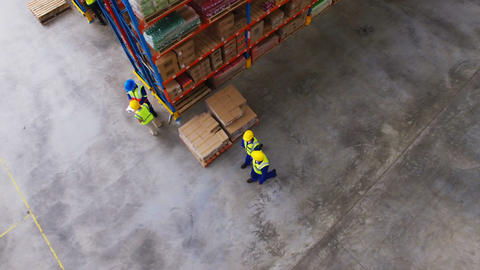 Warehouse worker interacting with each other while walking Live Action