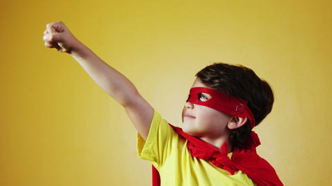 Boy pretending to be a superhero Footage