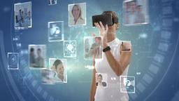 Businesswoman wearing virtual reality headset Footage
