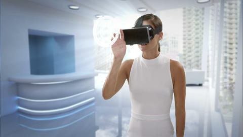Businesswoman wearing virtual reality headset Stock Video Footage