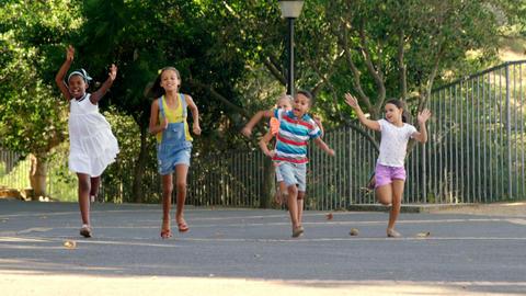 School kids running in school campus Live Action