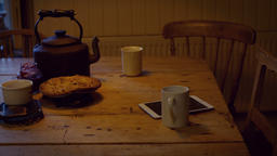 Coffee cup, digital tablet, food and teapot on table Live Action