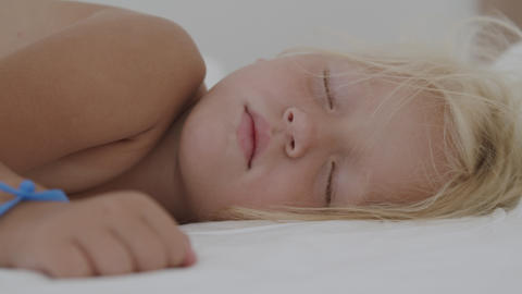 A sleeping blond girl Live Action