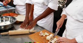 Three chefs working in the kitchen Footage