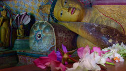 Panning video of lot Buddhas statues in sacred Golden Temple. Sri Lanka Footage