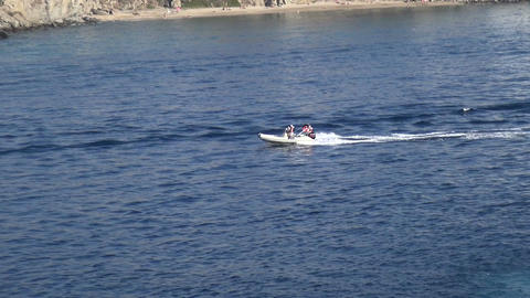 Small Inflatable Boat in the Sea Live Action