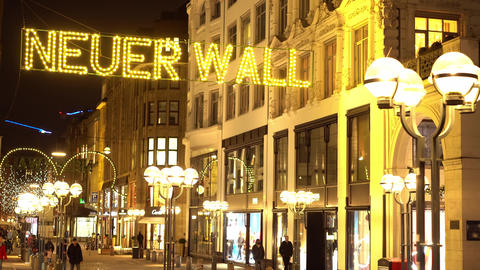 Famous street Neuer Wall in the city center of Hamburg by night Live Action