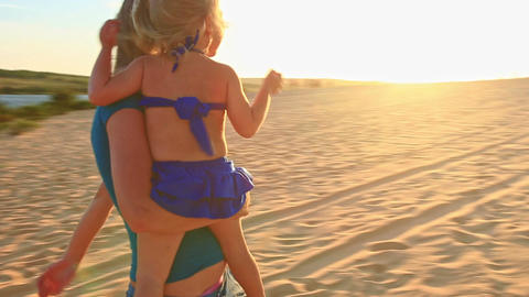 Mother Carries in Arms Small Girl on Dunes Shows Jeeps at Sunset Footage