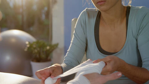 Woman wrapping hands Live Action