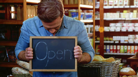 Owner holding open signboard slate Live Action