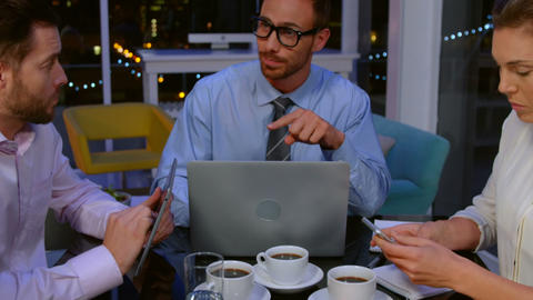 Businesspeople having discussion while having tea Footage