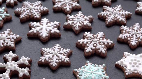 rotating gingerbread cookies snowflakes on slate table Live Action