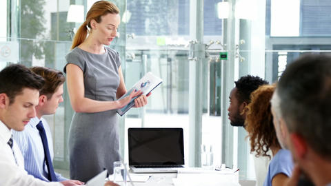 Businesswoman leading meeting in conference room Footage