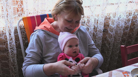 Grandmother with little baby girl Footage