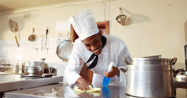 Chef cleaning work surface in commercial kitchen Live Action