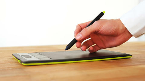 Hand of graphic designer using graphic tablet Live-Action