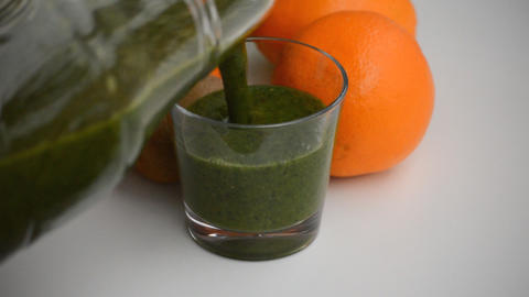 Slowly Pouring Green Smoothie Into Glass Footage