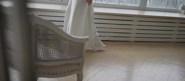 young girl in a morning white dress. Close-up of a girl in high heels and a long Live Action