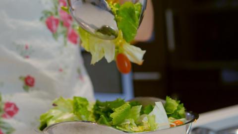 Girl preparing salad in kitchen Live Action
