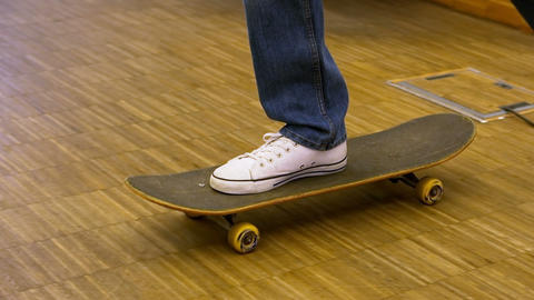 Low-section of business executive using skateboard Live Action