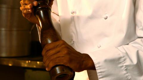 Chef using pepper grinder Live Action