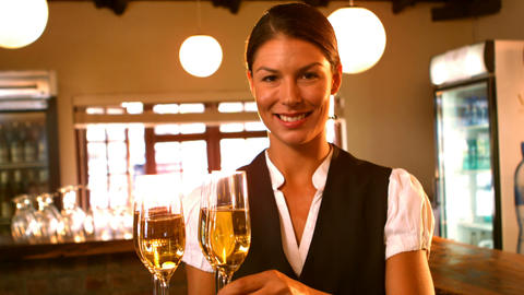 Female waitress serving a glass of champagne Footage