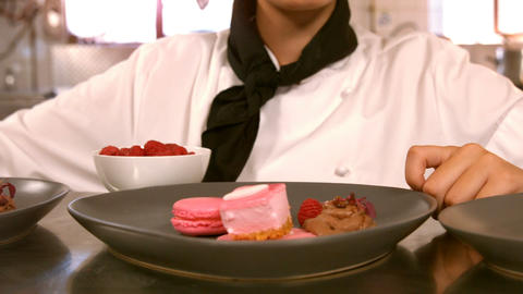 Female chef with dessert food on a counter Footage