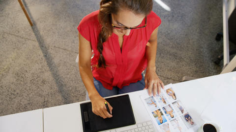 Female graphic designer using graphics tablet and computer Live-Action