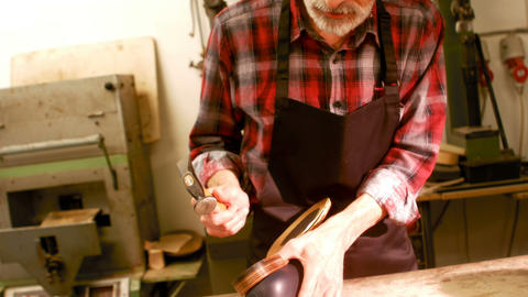 Cobbler hammering on a shoe Footage