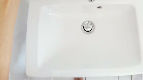 Woman washing hand in wash basin Footage