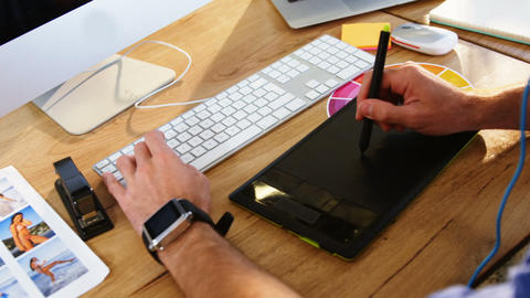 Graphic designer using graphics tablet Live-Action