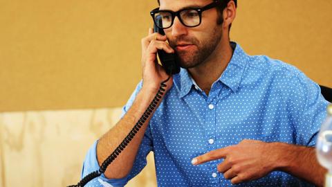 Business executives talking on telephone Footage