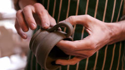 Mid section of potter making cup Footage