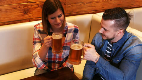 Couple toasting a glass of beer Footage