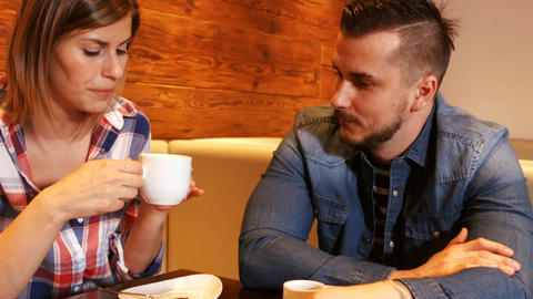 Couple interacting while having a cup of coffee Footage