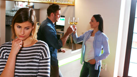 Couple toasting wine glasses while unhappy standing in front Stock Video Footage