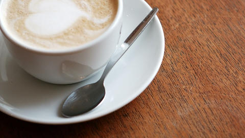 Cup of coffee latte at counter Footage