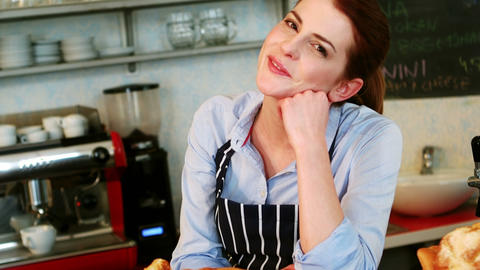 Portrait of smiling waitress standing at counter Footage